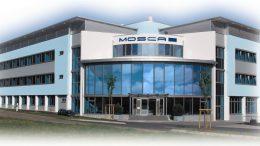 1983 ließ Firmengründer Gerd Mosca das erste Werk in Waldbrunn bauen; 2005 wurde das Produktionsgelände um 8.000 m2 Hallenfläche erweitert. Hier hat das Unternehmen heute seinen Hauptsitz.