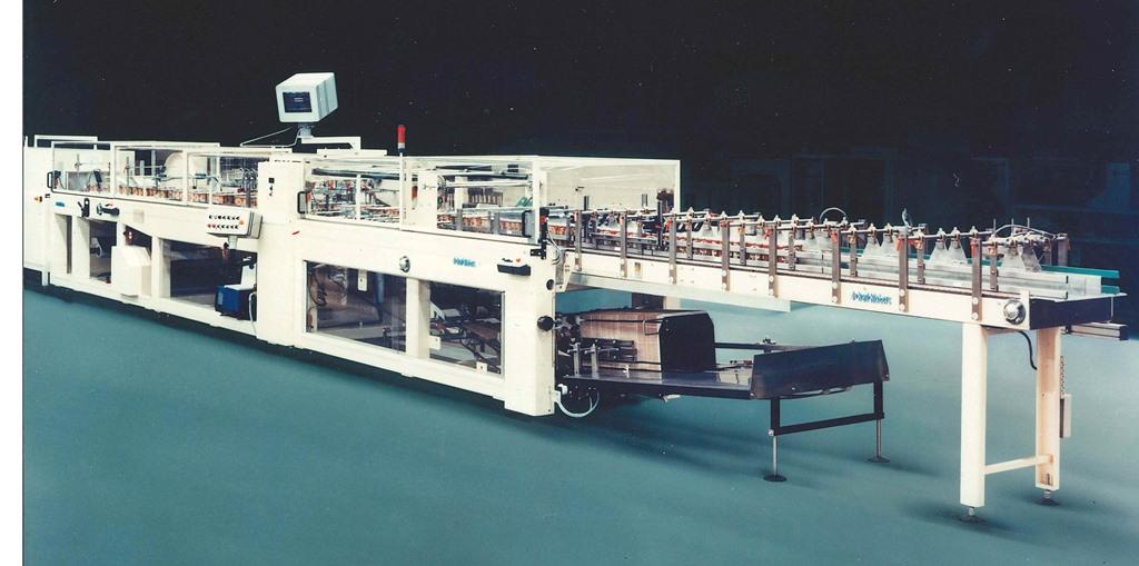 Sammelpacker Typ 197 von 1990 zur Herstellung von Tray- und Pad-Verpackungen mit und ohne Schrumpffolie, oder auch nur in Folie. (Bild: KHS)
