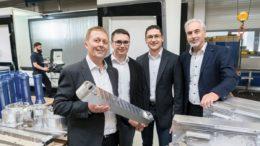 Bernd Fuchs, Marc Grieser und Jens Grieser (v.l.) mit dem scheidenden Geschäftsführer Manfred Grieser