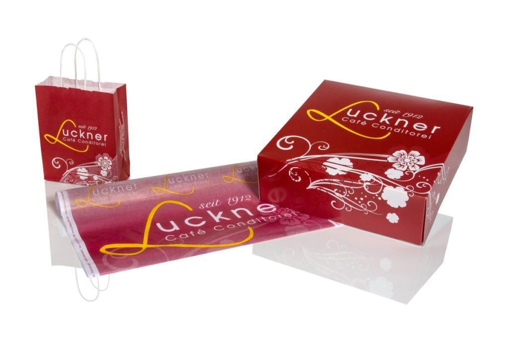 Sortiment aus Tortenschachteln, Pollenpapier und Papiertragetaschen von Bagman