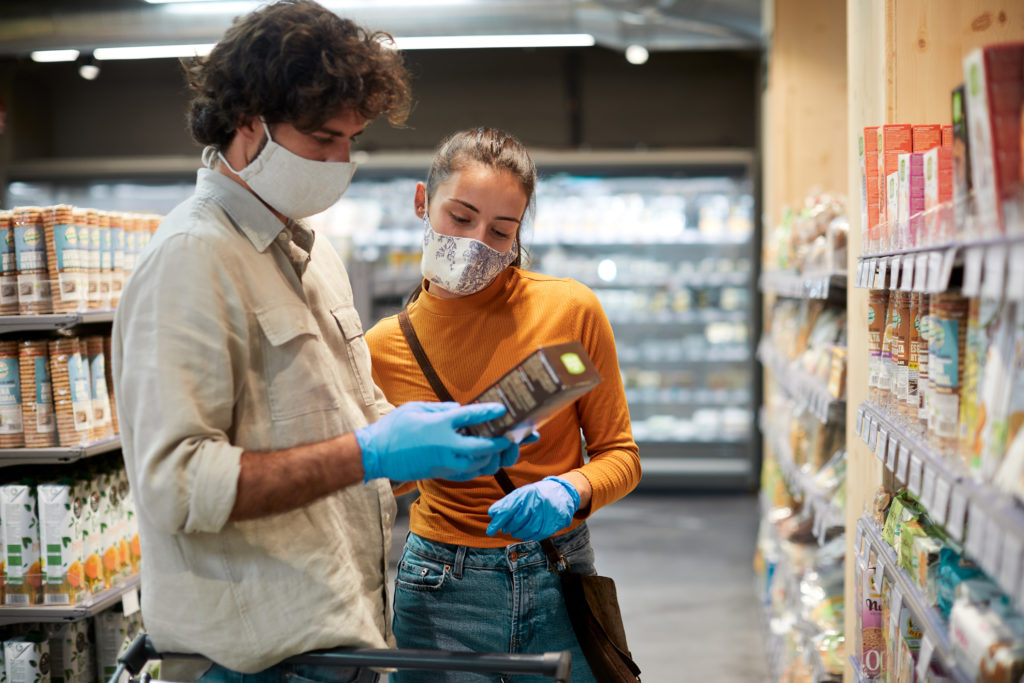 A young couple viewing a products label at the supermarket
